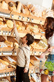 Grocery store - Woman and child choosing bread Stock Photography