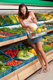 Grocery store: Woman in summer outfit Royalty Free Stock Photos