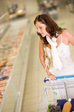 Grocery store - young woman shopping Royalty Free Stock Images