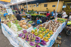 Grocery stores in Fiji. Suva, Fiji - Mar 24, 2017: View of people selling local produce at the grocery stores in Suva Market in Fiji Royalty Free Stock Photos
