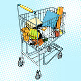 Grocery trolley with food Stock Photos
