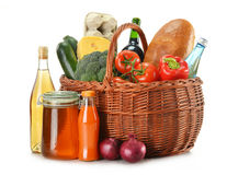 Grocery in wicker basket isolated on white Stock Photo