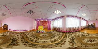 GRODNO, BELARUS -APRIL, 2016: Full seamless panorama 360 angle degrees view inside interior Assembly hall in kindergarten with royalty free stock images