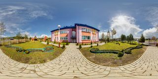 GRODNO, BELARUS -APRIL, 2016: Full seamless panorama 360 angle degrees view outside modern kindergarten in sunny summer day in. Equirectangular equidistant royalty free stock images