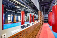 GRODNO, BELARUS - APRIL 2019: Hall of martial arts with fighting ring and punching bags in the modern Fight club royalty free stock images