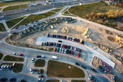Panoramic aerial view on new roadway and parking in urban development residential quarter from a royalty free stock image