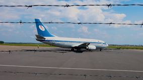 GRODNO, BELARUS - AUGUST 2019: the plane is preparing to take off. view from behind barbed wire stock video