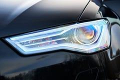 GRODNO, BELARUS - DECEMBER 2019: Audi A6 4G C7 Luxury Black car parts left front headlight and fog light with headlight