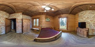 GRODNO, BELARUS - DECEMBER 26, 2016: Panorama in wooden bedroom in hunt vacation house in ancient style. Full spherical 360 by 180 stock photography