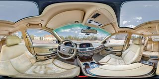 GRODNO, BELARUS - FEBRUARY 3, 2014: Full 360 equirectangular spherical panorama in the interior of prestige modern car bmw 750 royalty free stock photo