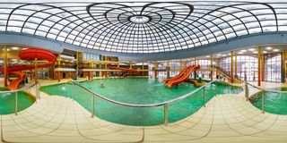 GRODNO, BELARUS - FEBRUARY 21, 2013: Panorama of interier hall swimming pool bathroom aquapark, full 360 seamless panorama in stock photography