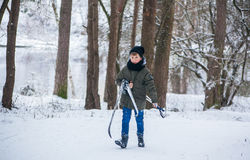 GRODNO, BELARUS - JANUARY 15, 2017. The boy in the winter forest carries skis Stock Image