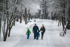 GRODNO, BELARUS - JANUARY 15, 2017. Family, father, mother, daughter and son walking in winter forest Royalty Free Stock Image