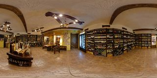 GRODNO, BELARUS - JANUARY 31, 2012: Interior of wine shop in ancient style, full 360 seamless panorama in equirectangular royalty free stock photos
