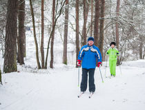 GRODNO, BELARUS - JANUARY 15, 2017. A senior couple outdoor in a winter setting. The active couple is about to go cross country sk Royalty Free Stock Photos