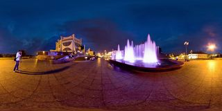 GRODNO, BELARUS - JULY 29, 2012: Night panorama in the center of the festive old european city near fountain. Full 360 by 180 royalty free stock photo