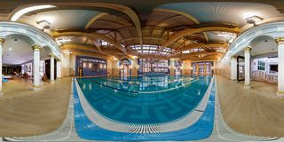 GRODNO, BELARUS - March 21, 2013: Full 360 degree equirectangular spherical panorama in the modern swimmig pool royalty free stock photography