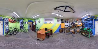 GRODNO, BELARUS - March 1, 2016: Full 360 equirectangular spherical panorama in the interior of Bicycle repair Iguana royalty free stock photos