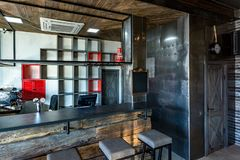 GRODNO, BELARUS - MARCH, 2019: inside interior in modern pub sport bar with dark loft design style with red chairs stock photos