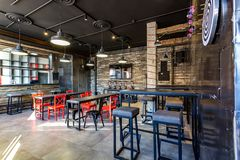 GRODNO, BELARUS - MARCH, 2019: inside interior in modern pub sport bar with dark loft design style with red chairs stock images