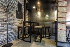 GRODNO, BELARUS - MARCH, 2019: inside interior in modern pub sport bar with dark loft design style with red chairs royalty free stock photo