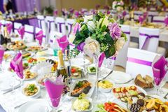 GRODNO, BELARUS - MAY 2014: Beautiful flowers on elegant dinner table in wedding day. Decorations served on the festive table in stock photos