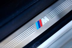 Grodno, Belarus, May 6, 2013 Symbol of the BMW M on the threshold in BMW 750 Li xDrive. Badge of BMW M series. Grodno, Belarus, May 6, 2013: Symbol of the BMW M stock photo