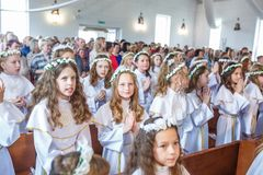 GRODNO, BELARUS - MAY 2019: Young children in the Catholic Church are waiting for the first eucharist communion. Little angels in royalty free stock images