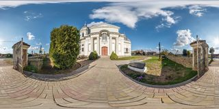 GRODNO, BELARUS - OCTOBER 2018: full seamless panorama 360 angle view near catholic church with awesome clouds  in equirectangular. Projection. Storage of waste stock images