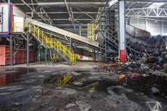 GRODNO, BELARUS - OCTOBER 2018: Modern waste recycling processing plant. Separate garbage collection. Recycling and storage of stock photos