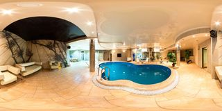 GRODNO, BELARUS - OCTOBER 11, 2010: panorama of swimming pool inside interior of luxury hotel . Full 360 degree seamless panorama stock images