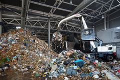 GRODNO, BELARUS - OCTOBER 2018 recycling plant process of upload. GRODNO, BELARUS - OCTOBER 2018: recycling plant process of uploading garbage to conveyor stock photography
