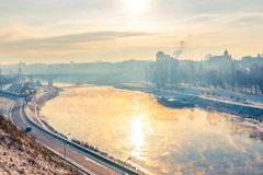 Grodno, Belarus. The sun reflected in the river Neman. Steam over water Royalty Free Stock Images
