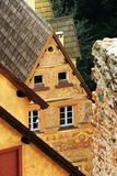 Grodno Castle in Zagorze Slaskie, Lower Silesia, Poland. Pitched shingle roofs of gatehouse building with precious sgraffito. Grodno Castle formerly Kynsburg on royalty free stock images