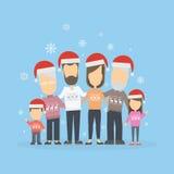 Große glückliche Familie in den Weihnachtshüten Stockfoto