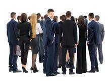 Große Gruppe Geschäftsleute in weißem mit buntem Kranz auf Kopf Stockfotografie