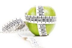 Groen Apple met een Metende Band Stock Afbeeldingen
