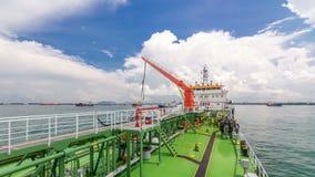 Groen dek van de tanker onder blauwe hemel timelapse stock video