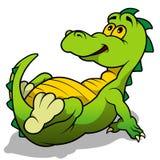 Groen Dino Laying Stock Foto's