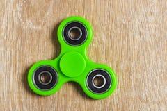 Groen friemel spinnerstuk speelgoed royalty-vrije stock foto's