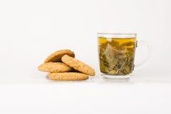 Groen thee en koekje Stock Afbeeldingen