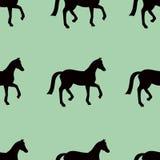 Groen vector naadloos patroon met zwarte paardensilhouetten Royalty-vrije Stock Foto