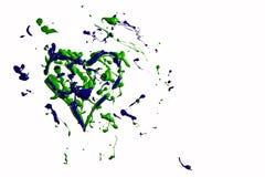 Groenachtig blauwe verfplons gemaakt tot hart Stock Afbeeldingen