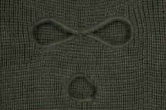 Groene abstracte achtergrond, een balaclava masker. Stock Afbeelding