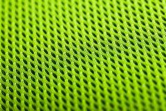 Groene Achtergrond De textuur van de netwerkstof Macro royalty-vrije stock foto's