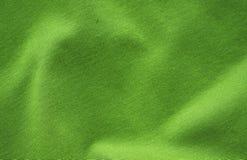 Groene achtergrond met de heldere abstracte stof van de doektextuur royalty-vrije stock afbeeldingen