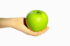 Groene appel in een hand Stock Foto