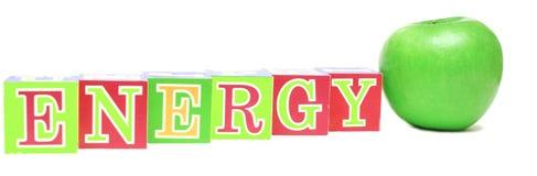 Groene appel en kubussen met brieven - energie Stock Afbeeldingen