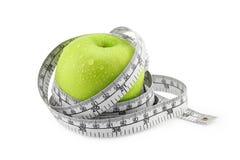 Groene appel met het meten van band Royalty-vrije Stock Fotografie