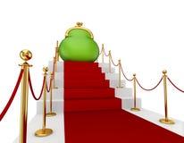 Groene beurs op een rode trap. Royalty-vrije Stock Afbeeldingen